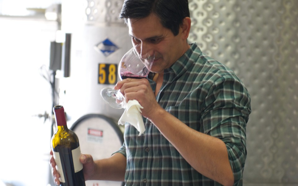 Winemaker tasting wine